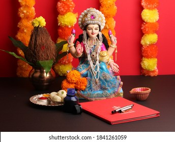 Lakshmi pujan - godess laxmi idol, Copper Kalash, coconut with Red accounting note book and haldi kumkum