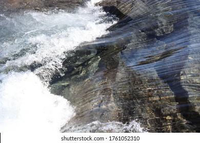 LAKSHOL, NORDLAND COUNTY / NORWAY - JUNE 12 2020: Water flow of Litlverivassforsen waterfall. Rago National Park in Northern Norway.