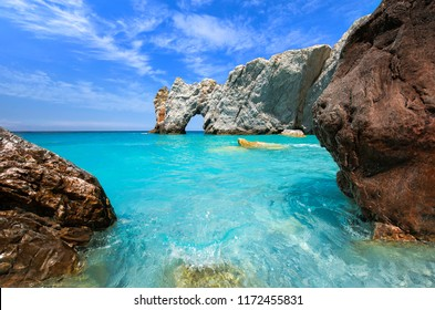 Lalaria beach in Skiathos with turquoise clear waters and two big rocks in the foreground