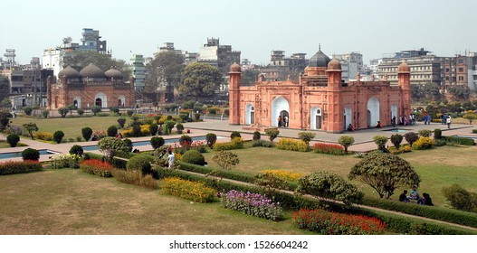 Lalbagh Fort in Dhaka, Bangladesh. This is the tomb of Bibi Pari in the grounds of Lalbagh Fort, Dhaka. To the left with three domes is Lalbagh Fort Mosque. Tourist sight in Dhaka, Bangladesh.