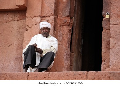 LALIBELA, ETHIOPIA - CIRCA NOVEMBER 2015: An old Ethiopian Orthodox priest outside a rock hewn church in Lalibela; one of Ethiopia's holiest cities and centre of pilgrimage.