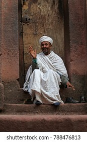 Lalibela, Ethiopia – December 15, 2010: Pilgrim at one of the old rock churches from Lalibela