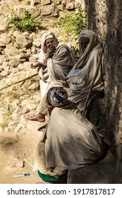 Lalibela, Ethiopia - Feb 14, 2020: Ethiopian people at the famous Monastery Neakuto Leab near Lalibela, Ethiopia, Africa