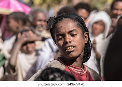 Lalibela, Ethiopia - January 27, 2012: One young woman performing traditional dance in the street of Lalibela during the Timkat holiday, the important Ethiopian Orthodox celebration of Epiphany.