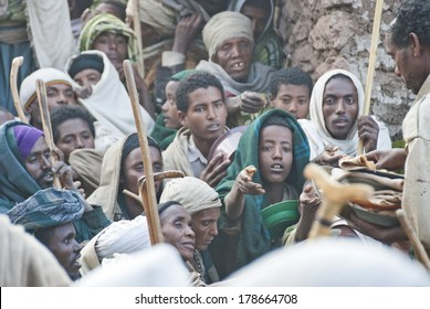 LALIBELA, ETHIOPIA - JANUARY 7: Unidentified volunteers hand out food to pilgrims after celebration of Orthodox Christmas on January 7, 2014, Lalibela, Ethiopia. Lalibela is overcrowded on Christmas.