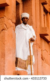 LALIBELA, ETHIOPIA - SEPTEMBER 27, 2011: Unidentified Ethiopian religious man near the Lalibela church cut off the rock. People in Ethiopia suffer of poverty due to the unstable situation.