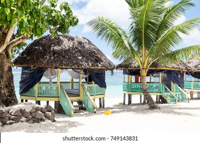 Lalomanu Beach, Upolu Island, Samoa - October 27, 2017: Colorful open-sided Samoan beach fale huts are an alternative to hotel or resort accommodation