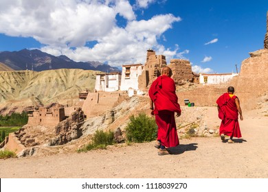 Lama walking to Basgo Gompa (Maitreya Temples) The mud-brick fortress is perched high in the hills of Ladakh, between the Himalaya and Karakoram mountain ranges in northern India.