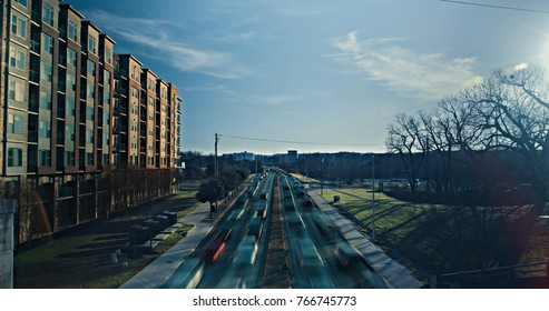 Lamar Boulevard in Austin, Texas shows congested traffic during rush hour in the evening hours as the sunsets.