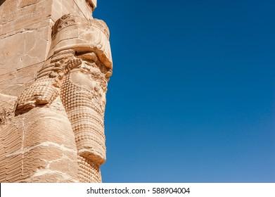 Lamassu statues an Assyrian guarding at gate of ancient city - Persepolis,Shiraz - Iran.