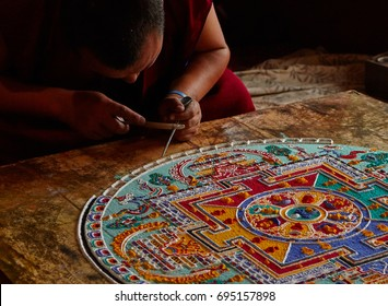 Lamayouro, Leh district, India. July 2017. Tibetian monks constructing mandala from colored sand  in Tibetan Buddhist monastery. Sand mandalas transmit positive energies  to the people who view them.