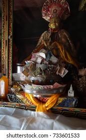 LAMAYURU GOMPA, LADAKH - SEP 13, 2017 - Donations of money on altar of the Lamayuru gompa monasteryLadakh, India