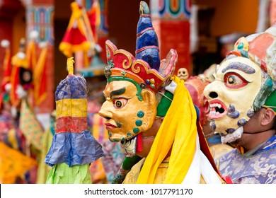 LAMAYURU, INDIA - JUNE 13, 2015 : Unidentified buddhist lamas dressed in mystical mask dancing Tsam mystery dance in time of Yuru Kabgyat Buddhist festival at Lamayuru Gompa, Ladakh, North India