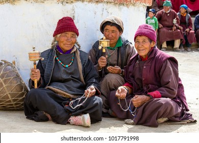 LAMAYURU, INDIA - JUNE 13, 2015: Unidentified buddhist old people during mystical mask dancing Tsam mystery dance in time of Yuru Kabgyat Buddhist festival at Lamayuru Gompa, Ladakh, North India
