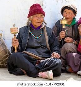 LAMAYURU, INDIA - JUNE 13, 2015: Unidentified buddhist old people during mystical mask dancing Tsam mystery dance in time of Yuru Kabgyat Buddhist festival at Lamayuru Gompa, Ladakh, North India