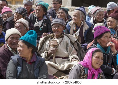 LAMAYURU, INDIA - JUNE 13, 2015: Unidentified buddhist old people during Tsam mystery in time of Yuru Kabgyat festival at Lamayuru Gompa, Ladakh, North India