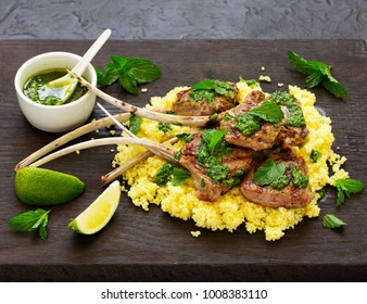 Lamb chops on bone, with mint-garlic sauce and couscous.