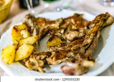 Lamb chops with potatoes in Italian restaurant