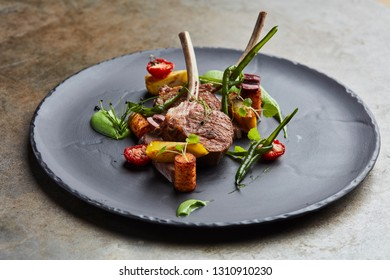 Lamb chops with vegetables and mint sauce