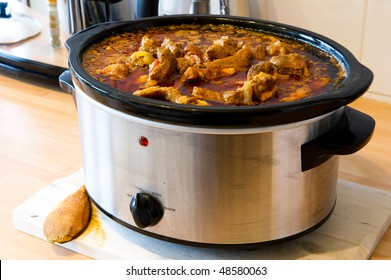 Lamb Curry cooking in slow Cooker with copy space.
