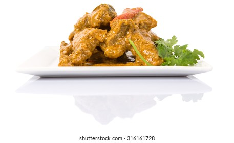 Lamb curry on a white plate over white background