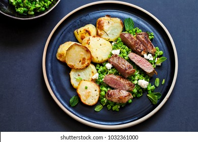 Lamb leg steak with crushed minted peas and roast potatoes