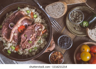 Lamb Loin Chops Freshly Roasted with Soybean and Couscous in Rustic Clay Dish