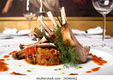 a lamb meat with vegetables on the table in the restaurant