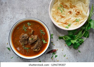 Lamb Mutton or goat curry served with Paratha, overhead view