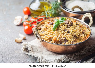 Lamb pilaf in a bowl on stone background with copy space