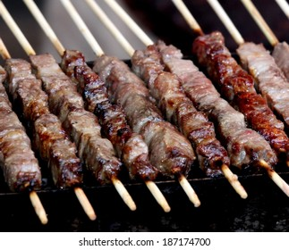 lamb roasted on glowing coals during a village Festival