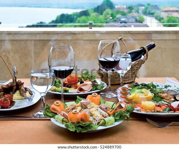 Lamb shank, sea bass, tuna fish salad and a variety of wine.