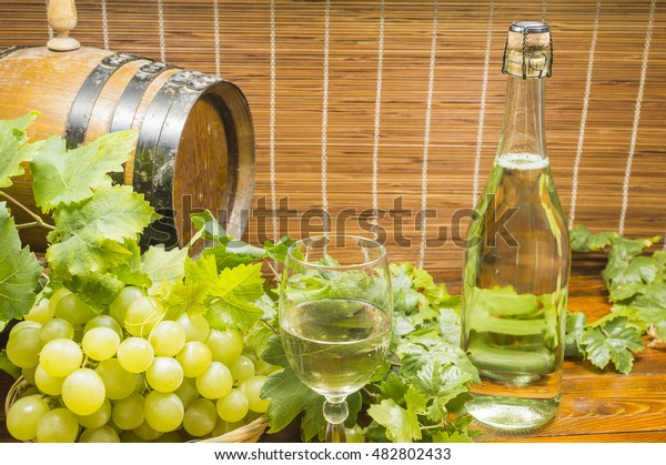lambrusco wine bottle, grapes and glass of wine