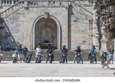 Lamego Portugal - 07 25 2019 : View at the staircase entrance with a group of bikers and motorcycles, Lamego Cathedral with a huge stairway
