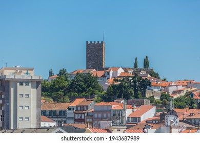 Lamego Portugal - 07 25 2019 : View at the city Lamego downtown and as background the tower at Castle of Lamego, an iconic monument building on the top at the city, portuguese patrimony