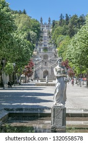 Lamego, Portugal, 5/10/2018: Statue of Summer in the park at the bottom of famous staircase leading to the Nossa Senhora dos Remedios church.