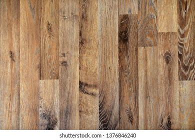 Laminated vintage oak wood floorboard texture from above