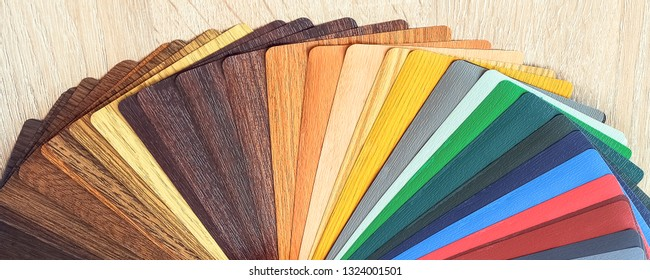 Lamination samples. On a wooden background for lamination of any wooden and plastic products used in construction.