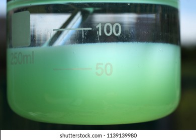 Lamination of water layers and colloidal precipitate of nickel carbonate.