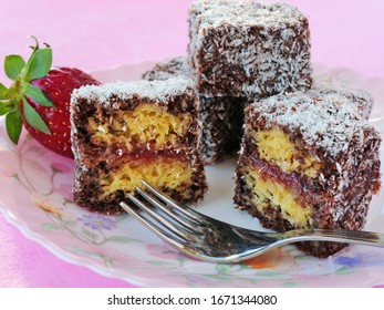 Lamington cake, squares of sponge cake coated in chocolate sauce and rolled in desiccated coconut