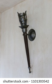 The lamp in the apartment, made as a mid-torch torch in the castle.