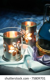 Lamp for aromatherapy with candles lit and breath-taking background.