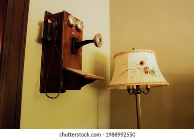 Lamp with Flower-patterned Shade next to Vintage Retro Antique Landline Wall Phone