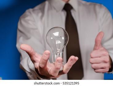 lamp in hand businessman
