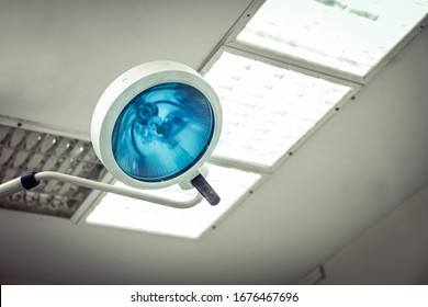 Lamp inside operating room in a hospital. Close up view with copy space.