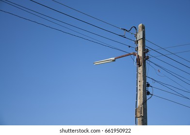 Lamp or Light bulbs grip Electric pole and wire on blue sky background