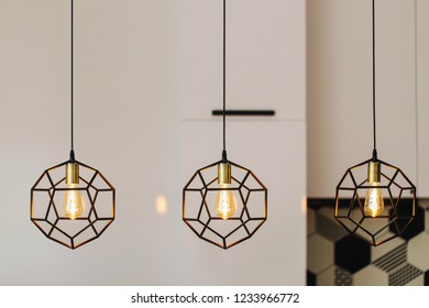Lamp in modern style with Edison's light bulb. Warm tone light bulb lamp. Stylish interior.