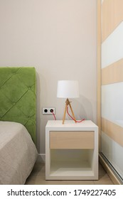 Lamp on the bedside table in the bedroom interior design