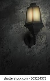 lamp on brick wall at night
