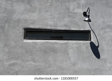 Lamp on a gray wall
